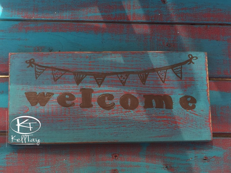 """WELCOME PENNANT""12X6 acrylic on pallet-$10"